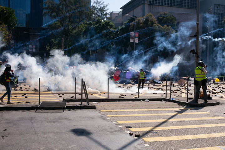Hong Kong street with clouds of teargas and rubble